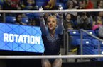 Florida's Alex McMurtry leaps onto the uneven bars during the Southeastern Conference gymnastics championships Saturday, March 24, 2018, in St. Louis. (Tim Vizer/St. Louis Post-Dispatch via AP)