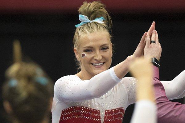 Arkansas Razorbacks Sarah Shaffer reacts following her vault during a gymnastics meet, Friday, January 26, 2018 at Barnhill Arena in Fayetteville.
