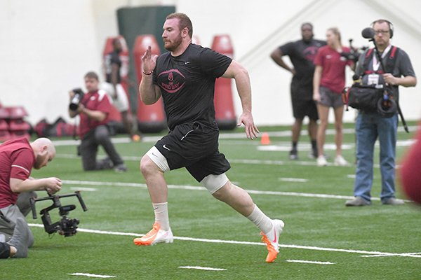 Arkansas offensive lineman Frank Ragnow runs during the Razorbacks' Pro Day on Monday, March 26, 2018, in Fayetteville.