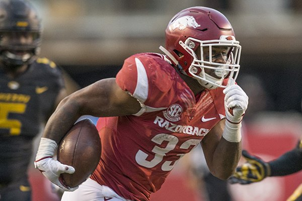 David Williams, Arkansas running back, runs for a 24 yard touchdown after a catch in the fourth quarter against Missouri Friday, Nov. 24, 2017, at Reynolds Razorback Stadium in Fayetteville.