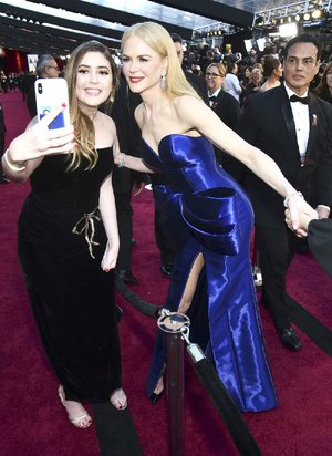 Actress Nicole Kidman (right) takes a selfie with fan at the Oscars earlier this month.