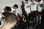 Loyola-Chicago chaplain Sister Jean Dolores Schmidt, leads the team in brayer before the first half of a regional final NCAA college basketball tournament game between Loyola-Chicago and Kansas State, Saturday, March 24, 2018, in Atlanta. (AP Photo/John Amis)