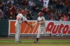 Arkansas shortstop Jax Biggers is congratulated by hitting coach Nate Thompson after Biggers hit a home run in the third inning of a game against Memphis on Tuesday, March 27, 2018, at AutoZone Park in Memphis, Tenn.