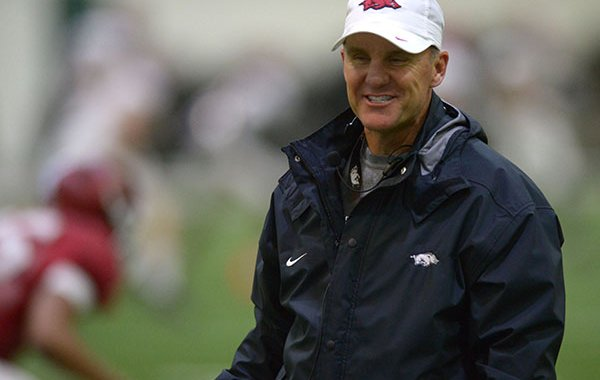 Arkansas coach Chad Morris speaks with players Wednesday, March 28, 2018, during practice at the university's practice facility on campus in Fayetteville.