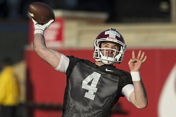 Arkansas quarterback Ty Storey throws a pass during practice Thursday, March 1, 2018, in Fayetteville.