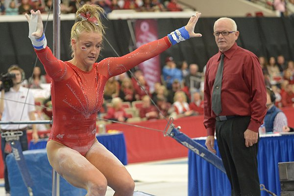 arkansas-sarah-shaffer-competes-friday-jan-12-2018-in-the-bars-portion-of-the-razorbacks-meet-with-kentucky-in-barnhill-arena-in-fayetteville-arkansas-coach-mark-cook-is-shown-watching-in-the-background