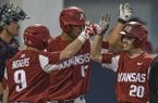 Arkansas' Carson Shaddy (20) celebrates his second-inning, two-run home run with teammates Jax Biggers (9) and Jordan McFarland (13) during an NCAA college baseball game against Mississippi in Oxford, Miss., Thursday, March 29, 2018. (Bruce Newman, Oxford Eagle via AP)