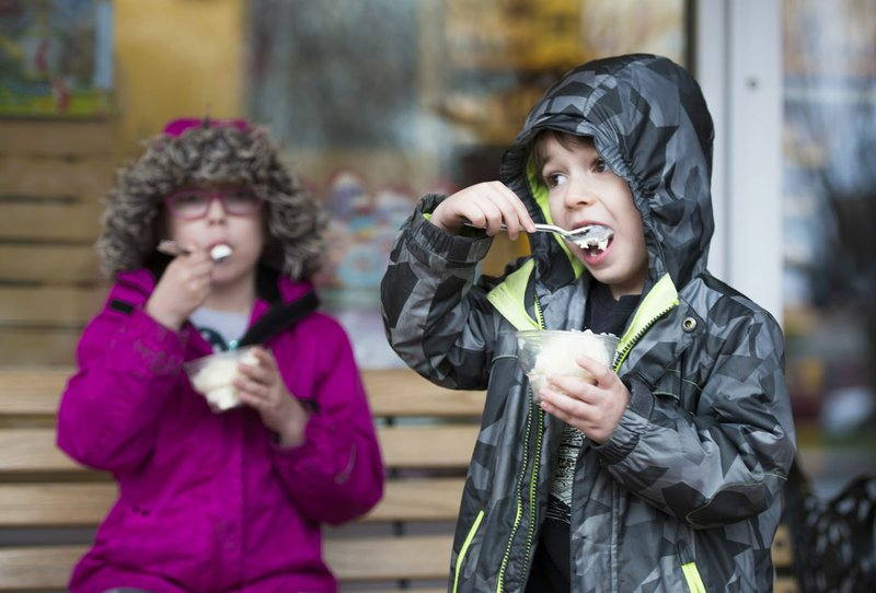 Henry Sosa From Right 4 And Lucy 6 Of Kansas City Mo Eat Ice Cream Thursday At The Walmart Museum In Bentonville