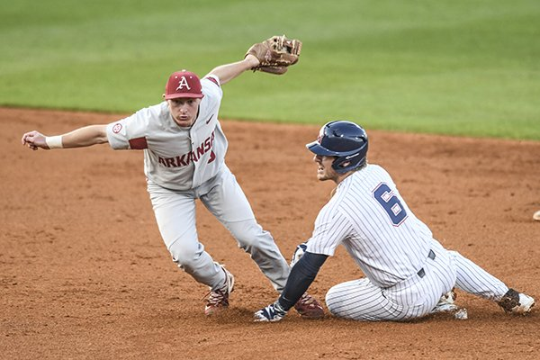 Arkansas' Jax Biggers (9) tags out Mississippi's Thomas Dillard (6) on a steal attempt during an NCAA college baseball game in Oxford, Miss. on Friday, March 30, 2018. (Bruce Newman/Oxford Eagle via AP)