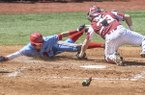 Mississippi's Ryan Olenek (2) is tagged out by Arkansas catcher Grant Koch (33) during an NCAA college baseball game at Oxford-University Stadium in Oxford, Miss. on Saturday, March 31, 2018. (Bruce Newman/The Oxford Eagle via AP)