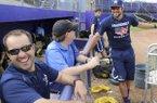 Kyle Parkinson, left, watches Vanderbilt's baseball practice on Monday, June 13, 2015, at Bellevue East High School in Bellevue, Neb.