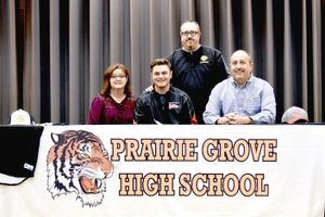Shelley Williams Special to the Enterprise-Leader Prairie Grove junior Chase Wade recently signed a National letter of intent to play men's college baseball for Coffeyville Community College of Coffeyville, Kan. Wade was accompanied by his parents, Carol (left) and Dwane Wade, and Prairie Grove baseball coach Chris Mileham.