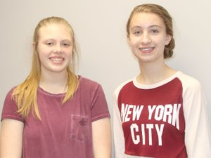 LYNN KUTTER ENTERPRISE-LEADER Carli Huffaker, left, and Madelyn Campbell, both seventh-graders in the EAST program at Lynch Middle School, have been creating logos for local businesses in town as part of a service project for their class.