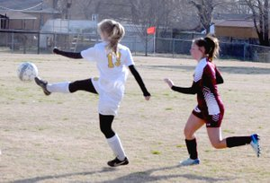 MARK HUMPHREY ENTERPRISE-LEADER Prairie Grove senior Stacey Johnson kicks the ball away during a girls soccer match held Monday, March 12, at Prairie Grove. The Lady Tigers and Gentry played to a scoreless tie.