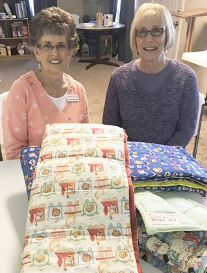 TIMES photograph by Annette Beard Cinda Wooldridge and Linda Pitts are organizing Stitched With Love to fill a need previously met by Grannies Quilts of Love, which disbanded this past year. An organizational meeting will be held at 9:30 a.m. Tuesday, April 17, in Mt. Vernon Presbyterian Church, North Davis Street, Pea Ridge.