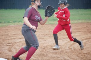 Graham Thomas/Herald-Leader Siloam Springs third baseman Ericka Galloway, left, anticipates the throw to third base during the first inning of Monday's 5A/6A District 1 softball game against Russellville. The Lady Cyclones defeated the Lady Panthers 18-3.