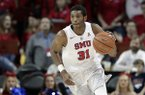 SMU guard Jimmy Whitt (31) handles the ball during an NCAA college basketball game against Houston on Wednesday, Feb. 28, 2018, in Dallas. (AP Photo/Tony Gutierrez)