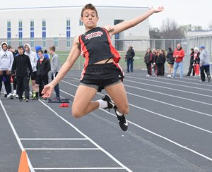 RICK PECK/SPECIAL TO MCDONALD COUNTY PRESS Michael Williams flies high on his way to a fifth place in the long jump at the Carthage Invitational.