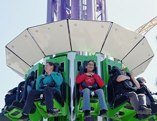 The Sentinel-Record/Grace Brown THRILLING: Karla McCaslin, center, holds on tight after riding Brain Drain, Magic Springs Theme & Water Park's new 13-story thrill ride, on Wednesday as part of the park's media preview day.