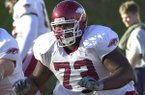 Arkansas' All-American tackle Shawn Andrews (73) goes through drills during practice in Fayetteville, Oct. 29, 2003. (AP Photo/April L. Brown)