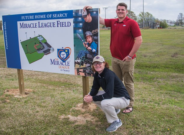 peyton-wright-kneeling-and-drew-vest-both-searcy-high-school-juniors-are-working-to-raise-money-for-a-miracle-league-baseball-field-which-will-be-built-on-higginson-street-the-project-is-part-of-the-students-environmental-and-spatial-technology-class-wright-helped-form-the-miracle-league-of-searcy-a-501c3-nonprofit-organization-and-the-first-fundraiser-a-powder-puff-football-game-is-scheduled-for-2-pm-saturday-at-searcy-lion-stadium-admission-is-5-and-donations-will-be-accepted-too