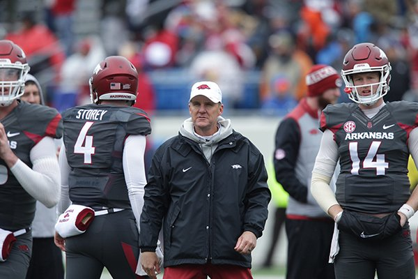 Arkansas coach Chad Morris watches quarterbacks warm up prior to the team's spring game Saturday, April 7, 2018, at War Memorial Stadium in Little Rock.