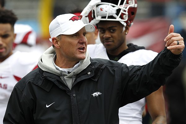 Arkansas coach Chad Morris talks to players during a scrimmage Saturday, April 7, 2018, at War Memorial Stadium in Little Rock.