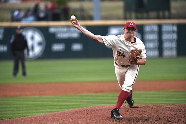 Arkansas pitcher Jake Reindl throws during a game against Auburn on Sunday, April 8, 2018, in Fayetteville.