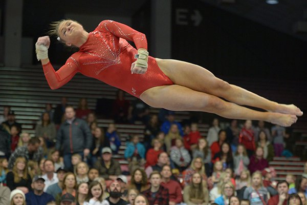 Arkansas' Amanda Wellick competes Friday, Jan. 12, 2018, in the vault portion of the 11th-ranked Razorbacks' meet with sixth-ranked Kentucky in Barnhill Arena in Fayetteville.