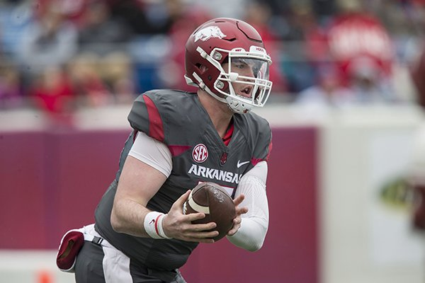 Arkansas quarterback Cole Kelley runs during the Razorbacks' spring game Saturday, April 7, 2018, in Little Rock.