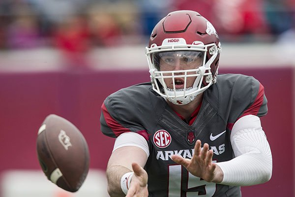 Arkansas quarterback Cole Kelley takes a snap during the Razorbacks' spring game Saturday, April 7, 2018, in Little Rock.