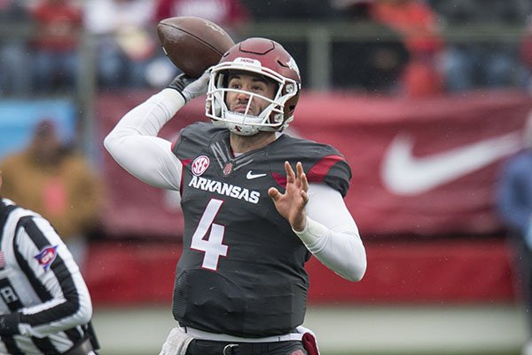 Arkansas quarterback Ty Storey throws a pass during the Razorbacks' spring game Saturday, April 7, 2018, in Little Rock.
