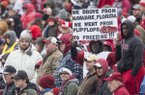 A fan holds up a sign during Arkansas' spring game Saturday, April 7, 2018, in Little Rock.