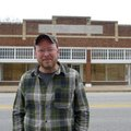 Charlie Bookout, one of the owners of The Carpenter Building in Gentry, stands in front of the build...