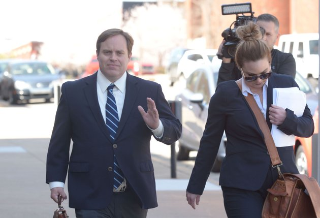 former-state-sen-jon-woods-walks-alongside-his-attorneys-outside-the-john-paul-hammerschmidt-federal-building-in-fayetteville-on-wednesday-april-4-2018
