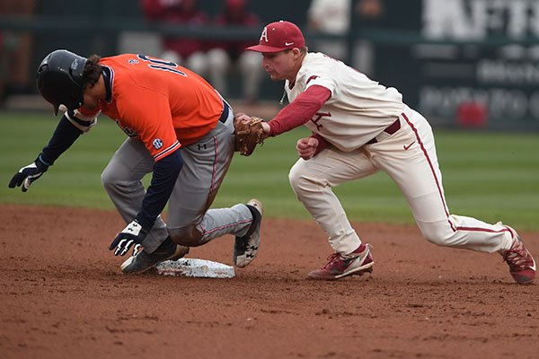 Arkansas shortstop Jax Biggers attempts to tag Auburn's Edouard Julien at second base during a game Sunday, April 8, 2018, in Fayetteville.