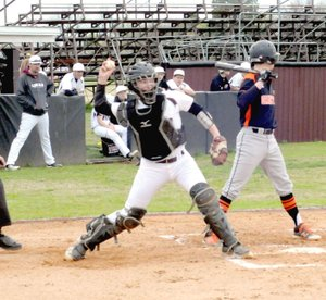 MARK HUMPHREY ENTERPRISE-LEADER Lincoln baseball coach Justin Bounds watches as the Wolves' catcher Josh Jetton attempts to throw out a runner stealing second. Lincoln lost 15-1 to Gravette Thursday.