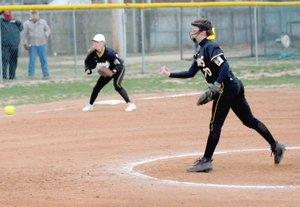 MARK HUMPHREY ENTERPRISE-LEADER Prairie Grove senior Laney Layman delivers a pitch for the Lady Tigers. Layman (59 pitches) alternates with junior Madie Stearman (39 pitches) in the chalked circle. Both threw three innings during a 10-3 loss at Pea Ridge on Monday, March 5.