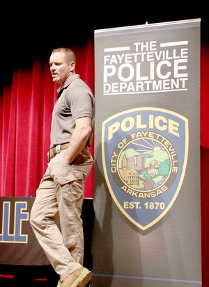 LYNN KUTTER ENTERPRISE-LEADER Sgt. Tony Murphy with the community police division of Fayetteville Police Department, talks to Lincoln Middle School students about a career in law enforcement.