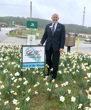Photo Submitted Pictured is Mayor Peter Christie standing in a beautiful patch of blooming daffodils in front of Bella Vista Fire Department Station 1.