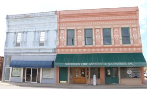LYNN KUTTER ENTERPRISE-LEADER The State Review Board of Arkansas Historic Preservation Program has nominated two commercial districts in downtown Prairie Grove for the National Register of Historic Places. The North Mock Street Commercial Historic District includes these two buildings at 114 and 116 N. Mock St. The other district is the south side of Buchanan Street.