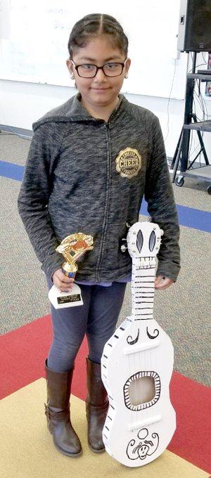 Photo submitted Miriam Lopez tied for second place in the Southside Elementary School instrument contest last month.