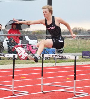 """TIMES photograph by Annette Beard Blackhawk Zach Woods took second place in pole vault clearing 12'6""""."""