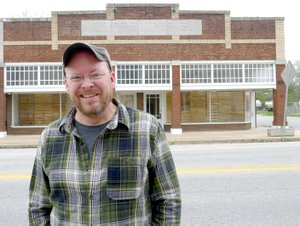 Charlie Bookout, one of the owners of The Carpenter Building in Gentry, stands in front of the building on Friday. The building is being nominated for inclusion on the National Register of Historic Places.
