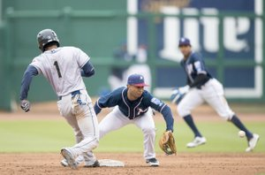 Charlie Kaijo/NWA Democrat-Gazette Northwest Arkansas Naturals shortstop Jecksson Flores (2) tries to tag San Antonio Missions left fielder Rod Boykin (1) during a baseball game on Sunday at Arvest Ballpark in Springdale. The Naturals wrapped up a six-game homestand Tuesday and begin a six-game road trip in Corpus Christi at 7:05 p.m. Thursday. The Naturals return home for two games against Tulsa on April 19-20.