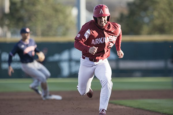 Arkansas outfielder Dominic Fletcher runs to third base during a game against Auburn on Saturday, April 7, 2018, in Fayetteville.
