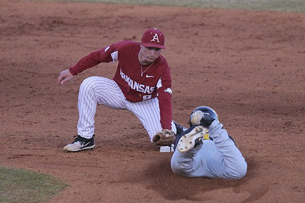 Arkansas shortstop Jax Biggers tags out Grambling State baserunner Kristian Franklin during a game Tuesday, April 10, 2018, at Dickey-Stephens Park in North Little Rock.