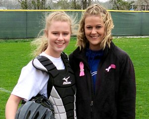 """Taylor Norman (left) stands with her mother, Kristin Ferguson, on Tuesday, April 3, at Reynolds Memorial Complex in Gentry. Gentry played Greenland in a high school softball game dubbed """"No One Fights Alone"""" to bring more awareness to breast cancer. The players, coaches and managers of each team dedicated the game in honor of, or in memory of, someone who has battled breast cancer. Both teams wore special jerseys during the game. Ferguson is a breast cancer survivor and threw out a ceremonial first pitch to her daughter before the start of the game."""