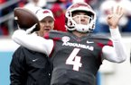 Arkansas coach Chad Morris watches as quarterback Ty Storey throws a pass during warmups prior to the Razorbacks' spring game Saturday, April 7, 2018, in Little Rock.