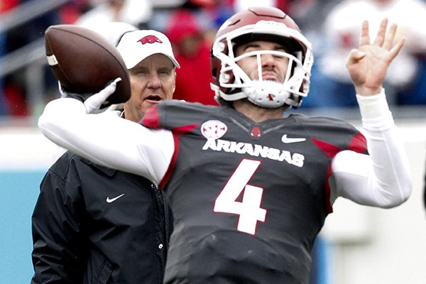 arkansas-coach-chad-morris-watches-as-quarterback-ty-storey-throws-a-pass-during-warmups-prior-to-the-razorbacks-spring-game-saturday-april-7-2018-in-little-rock